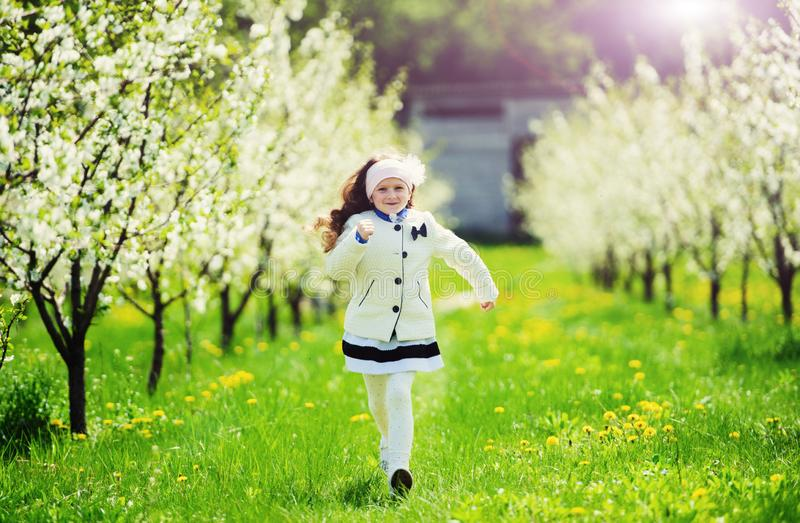 Little pretty girl in the green garden stock image