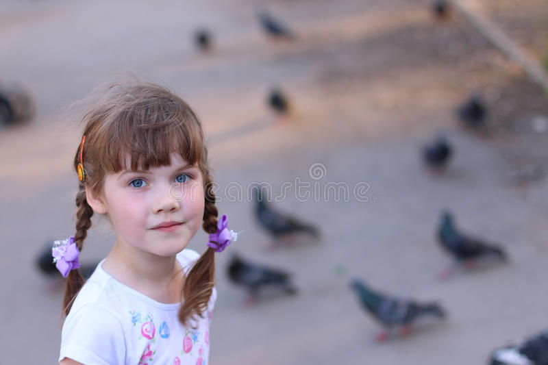 Little pretty girl with pigtails smiles royalty free stock images