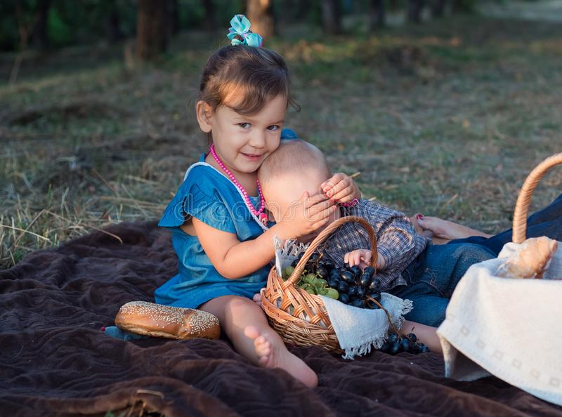 Little pretty girl and young boy hugging each other on autumn day. Happy children royalty free stock photos