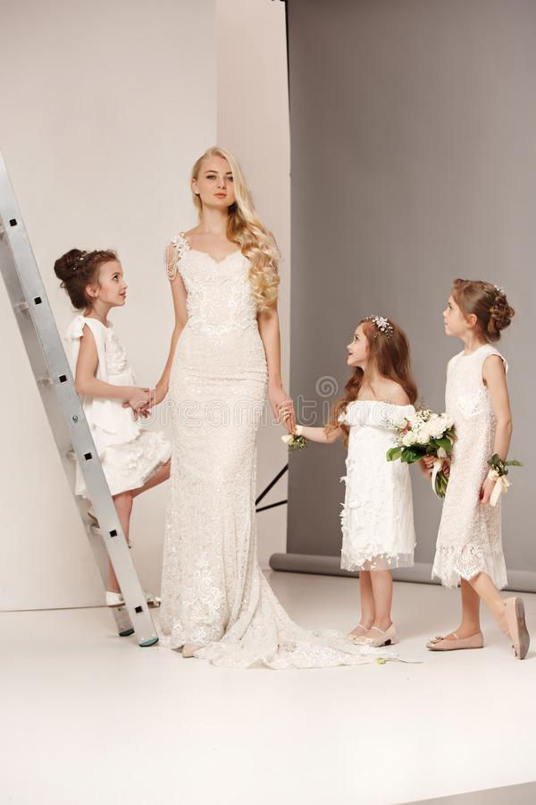 Little Pretty Girls With Flowers Dressed In Wedding Dresses Stock ...