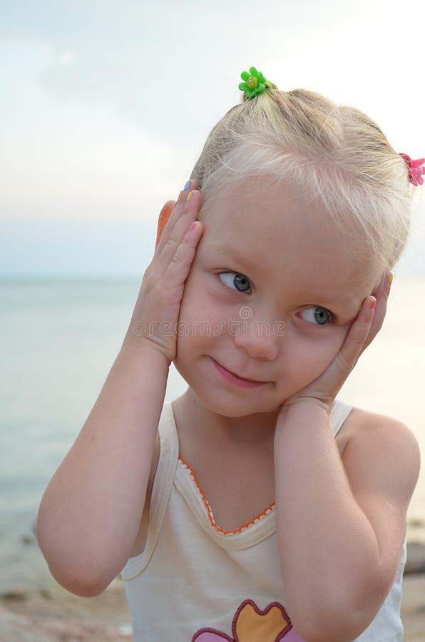 Little pretty shy girl stock photography