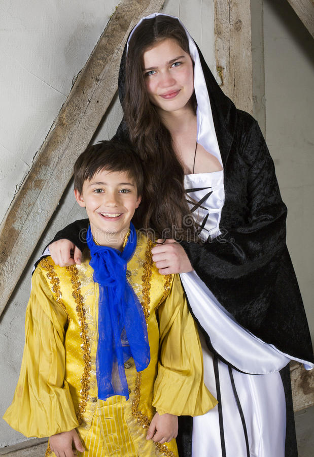 Little prince and princess. Young girl dressed as princess and little boy dressed as prince royalty free stock photography