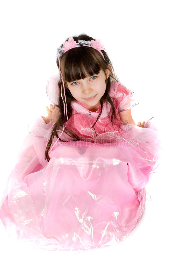 Little Princess. Little girl in a pink princess dress. Taken in studio and isolated on a white background stock photo