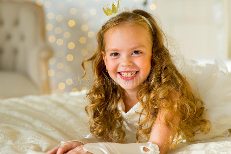 Little princess on the bed stock photo