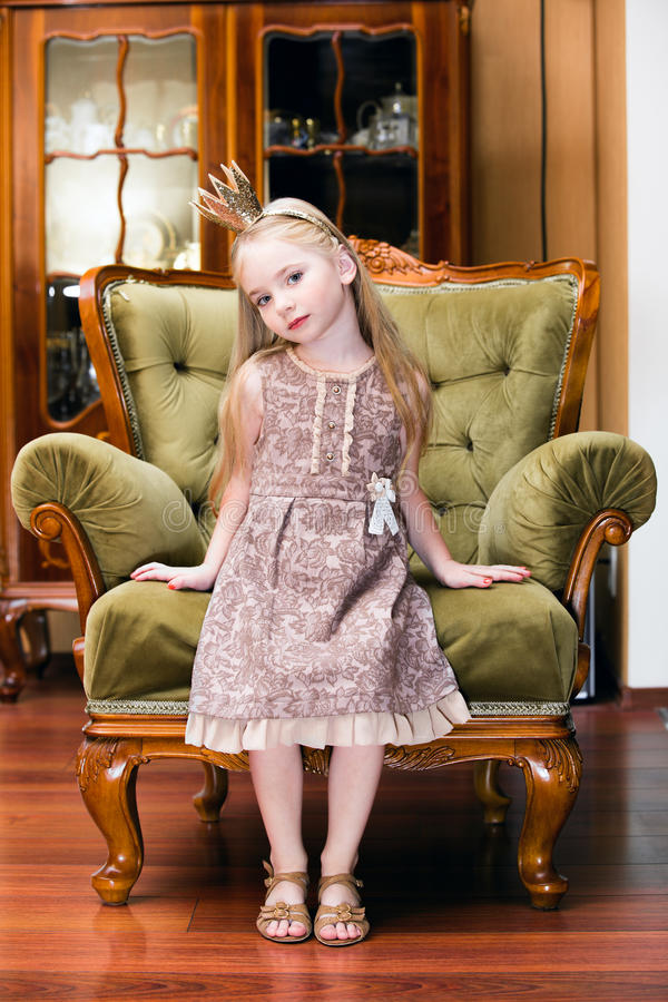 Little princess on a chair stock image