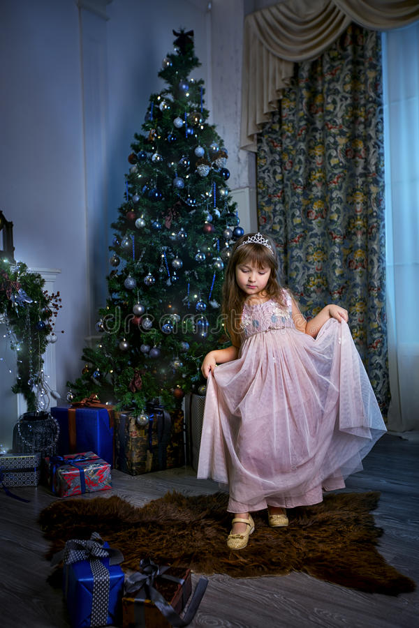 Little princess in christmas interior stock image