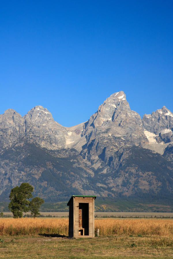 A Little Privacy Please. This majestic landscape features rugged mountains in Grand Teton National Park towering above the prairie in a quintessential American royalty free stock image