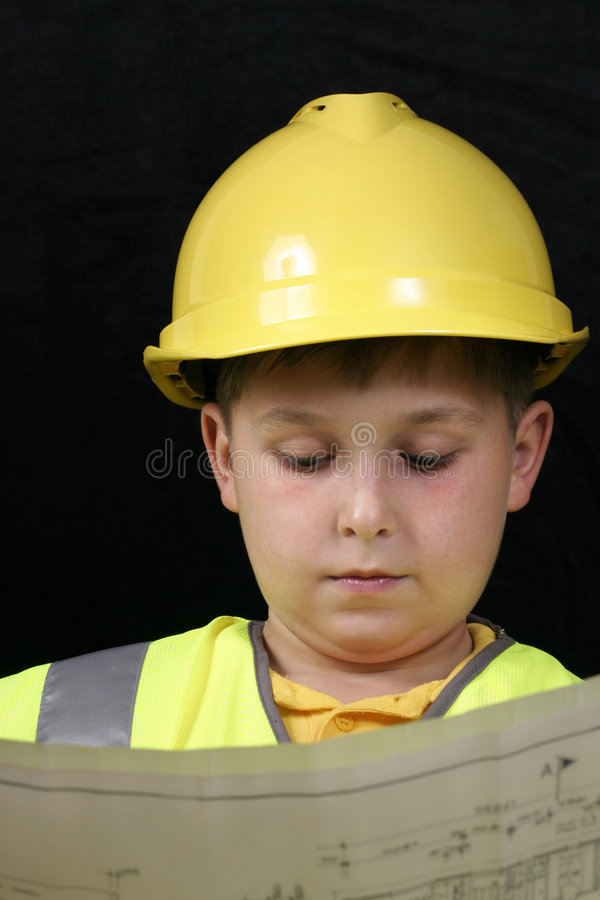 Little Project Manager. Young project manager reviews the plans royalty free stock image