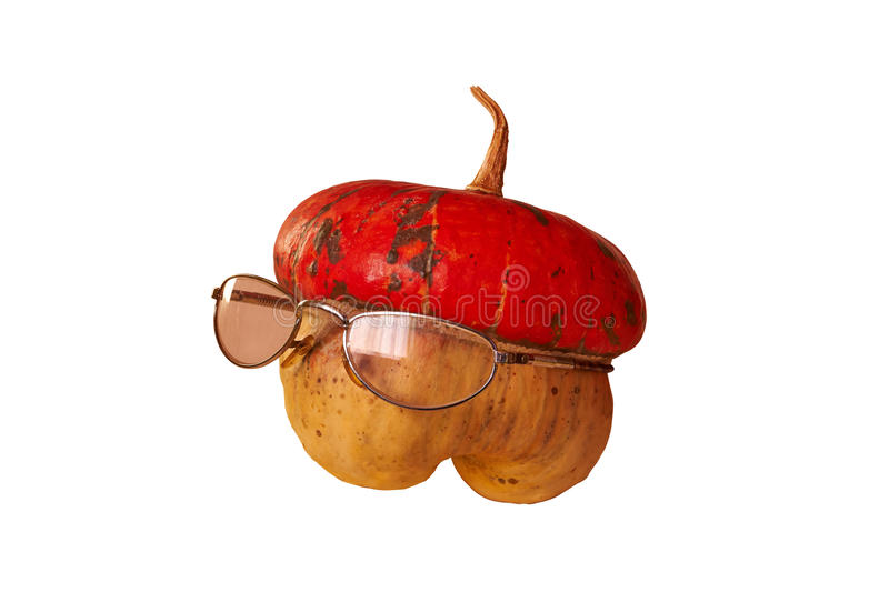 Little pumpkin with glasses. Little pumpkin with transparent glasses on white background stock photo