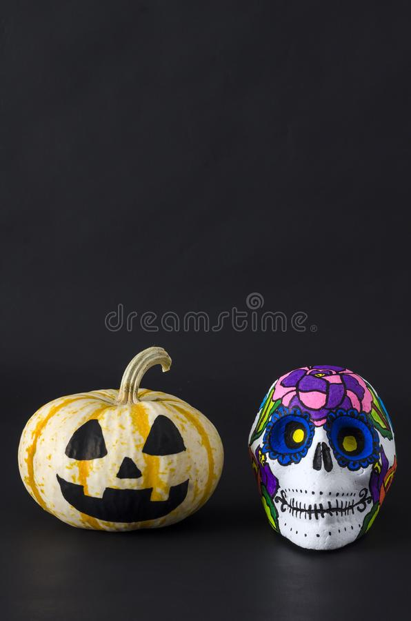 Little pumpkin and skull. Halloween and mexican Day of the dead royalty free stock photography