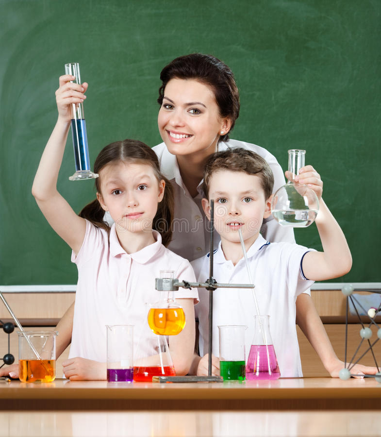 Download Little Pupils Study Chemistry With Their Teacher Stock Image - Image: 26219103