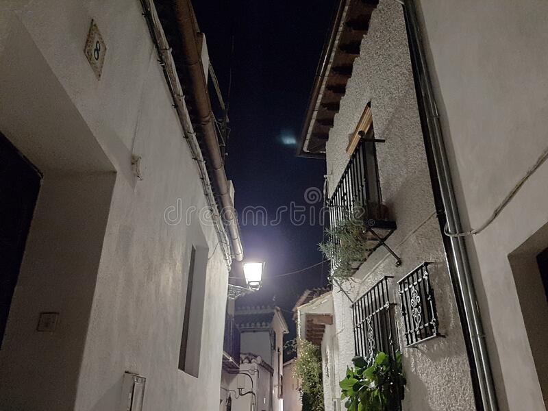 A little quiet street by night in Granada, Spain royalty free stock image