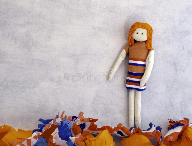 Orange haired rag doll with Kings dag & x28;Koningsdag in Dutch& x29; decorations stock photo