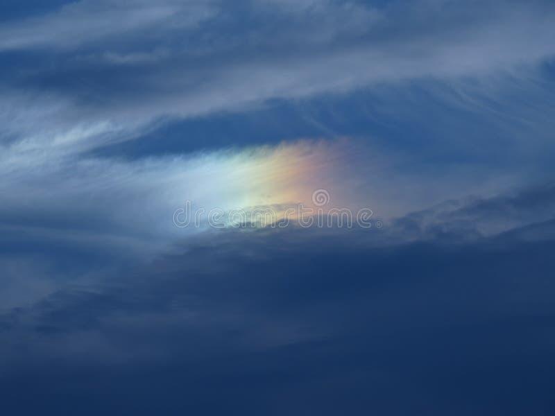 Little rainbow on the dark sky stock photo