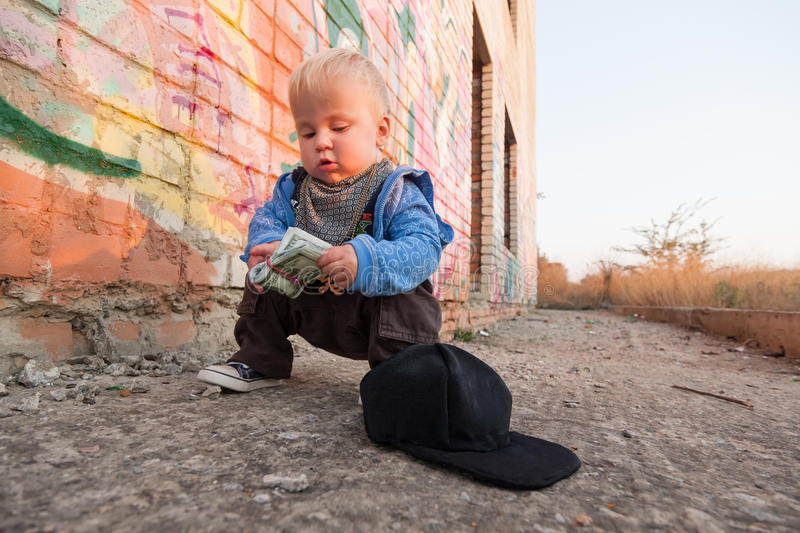 Little rapper. With money in a deserted place stock photo