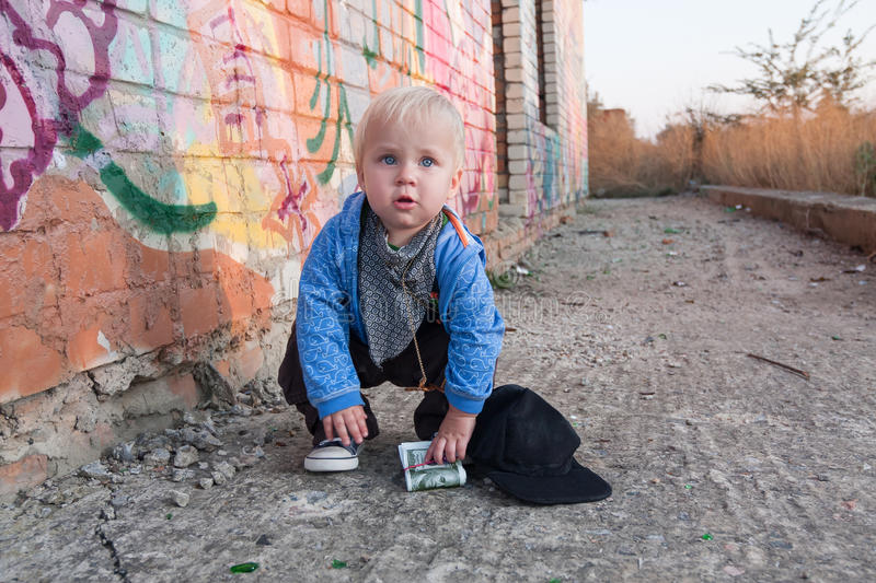 Little rapper. With money in a deserted place stock image