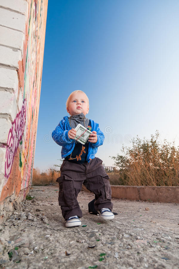 Little rapper. With money in a deserted place stock images