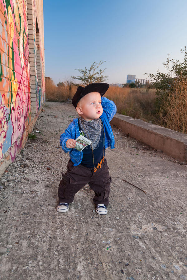 Little rapper. With money in a deserted place royalty free stock images