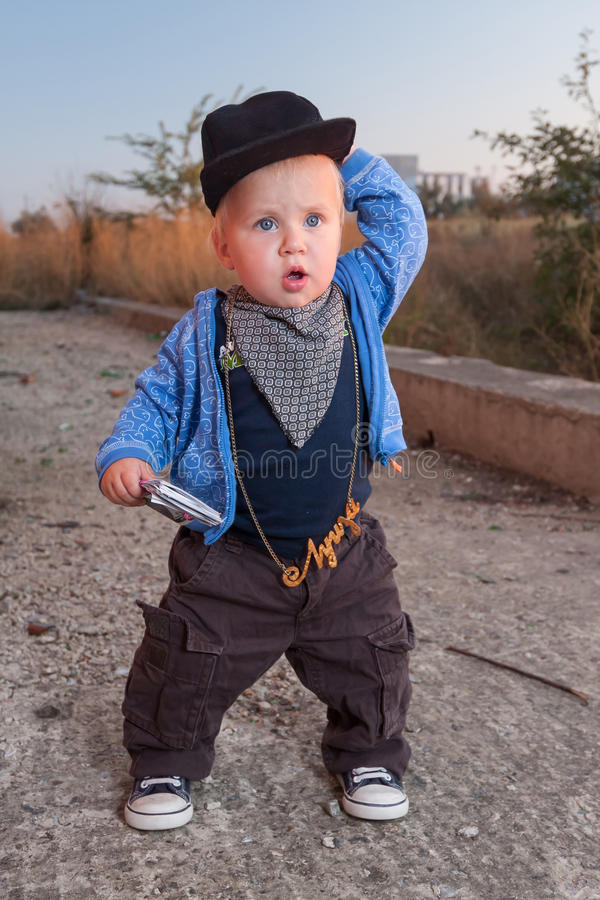 Little rapper. With money in a deserted place royalty free stock photos