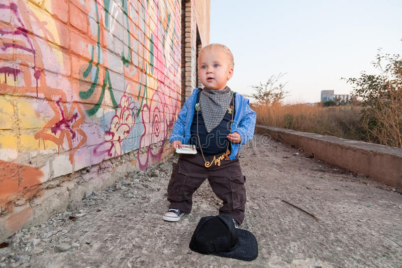Little rapper. With money in a deserted place royalty free stock photo