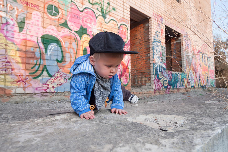 Little rapper. With money in a deserted place stock photography