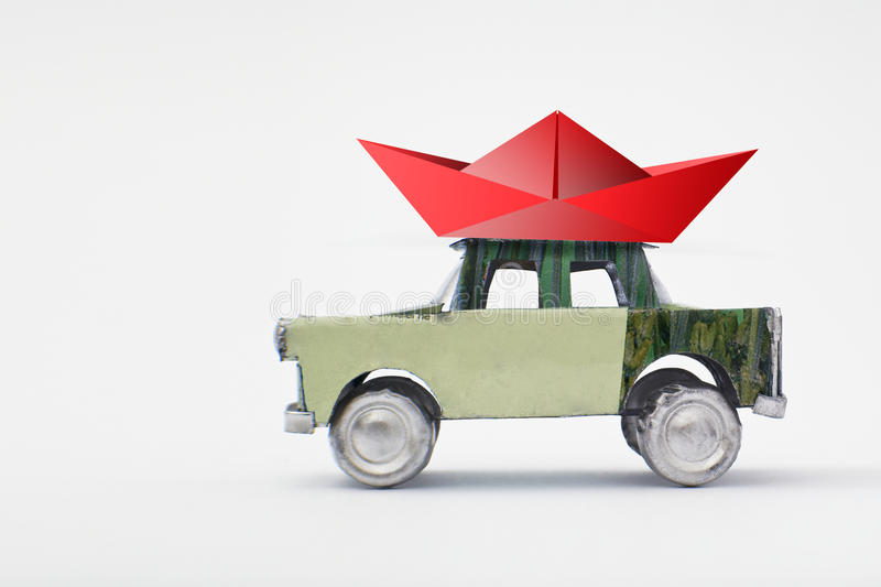 Little red boat on a model car. Holidays concept royalty free stock photography