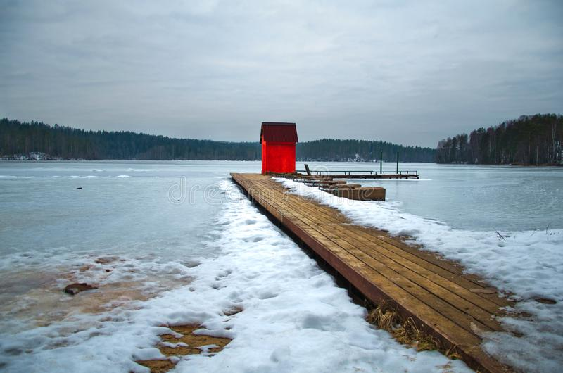 Little red boathouse on the dock royalty free stock photo