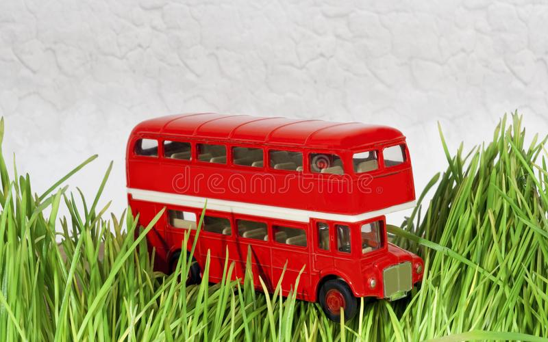 Little red decorative bus on the grass stock photo