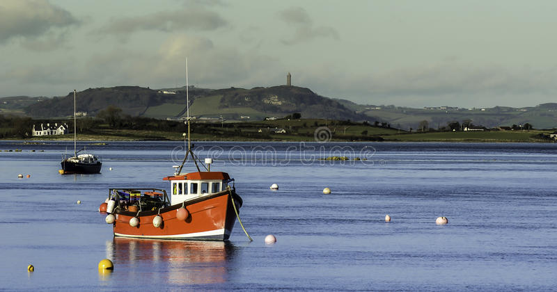 Little Red Fishing Boat. Fishing Boat on Strangford Lough with Scrabo Tower in the background stock images