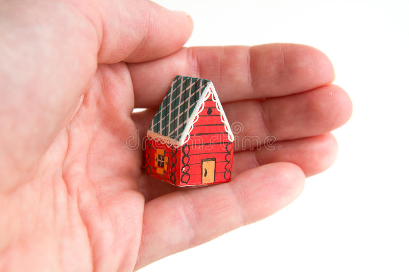 Download Little red house in a hand stock image. Image of human - 79453251