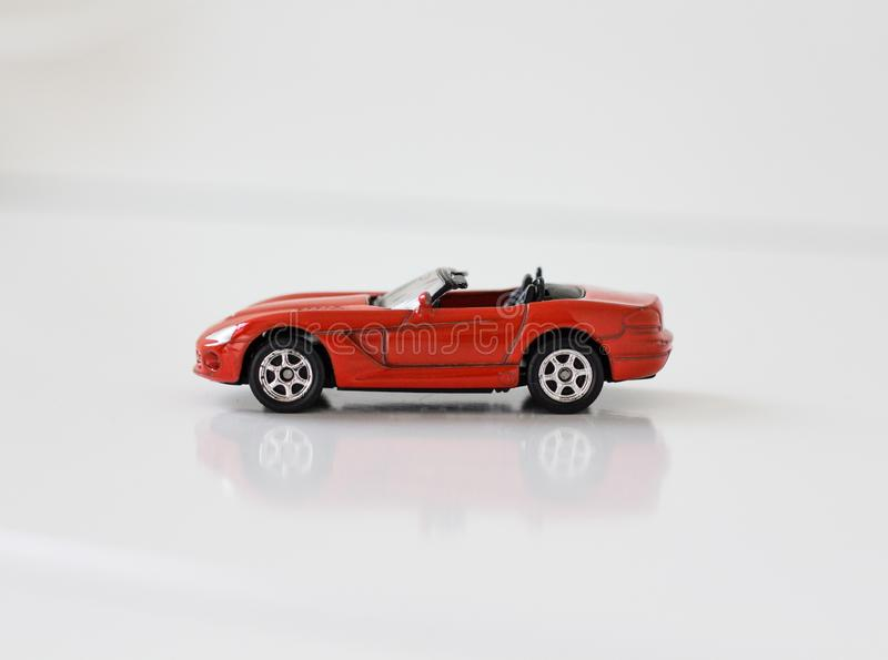 Little red toy sports car on a white background royalty free stock photos