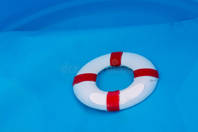 Little red and white color model life buoy stock photos