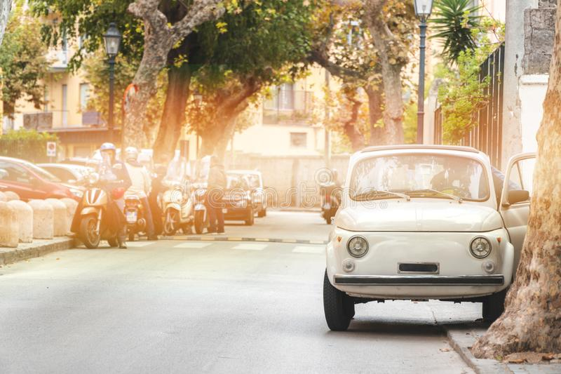 Little retro car on the street old vintage, beautiful summer day in Italy, travel tour.  stock image