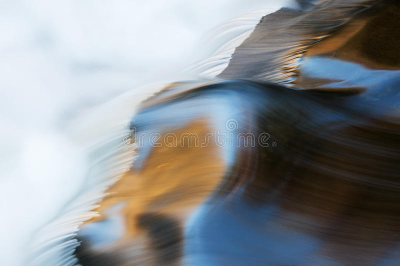 Little River Rapids. Captured with motion blur and illuminated by reflected color from sunlit spring foliage and blue sky overhead, Great Smoky Mountains royalty free stock photos