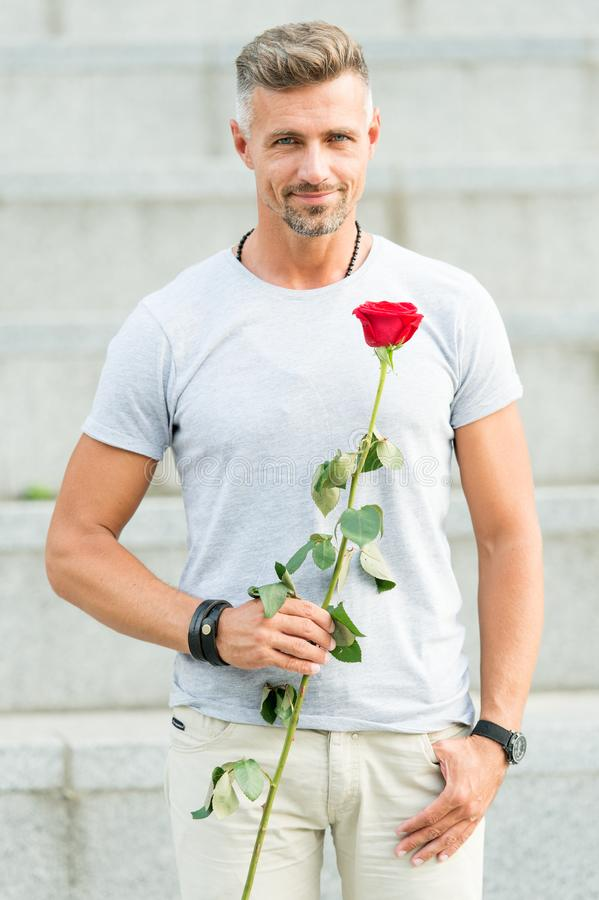 Little romance can enhance your love life. Handsome guy with rose flower romantic date. Valentines day and anniversary stock image
