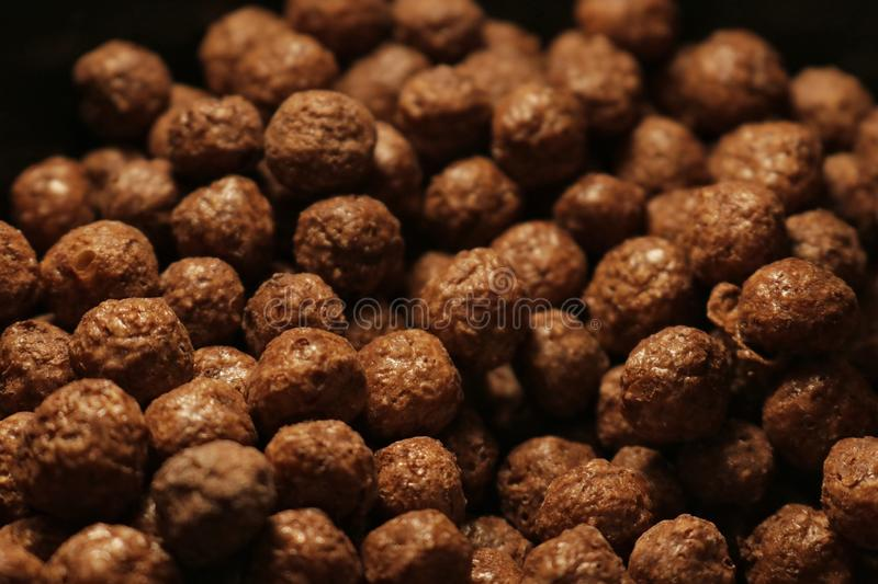 Little round brown chocolate flakes. Lots of little round brown chocolate flakes royalty free stock image
