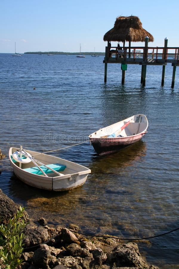 Little row boats. Small row boats by the reef and pier royalty free stock images