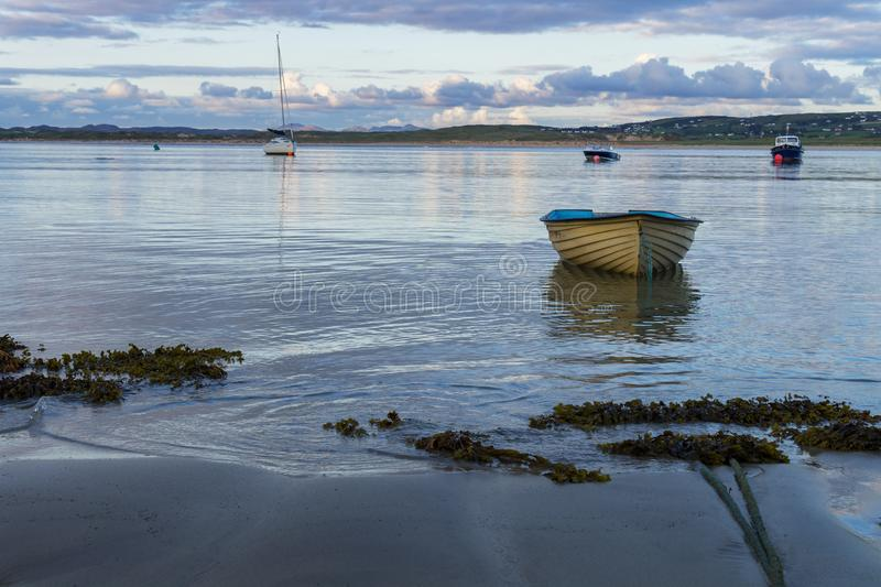A lonely rowing boat. A little rowing boat afloat on Sheephavens bay royalty free stock photo
