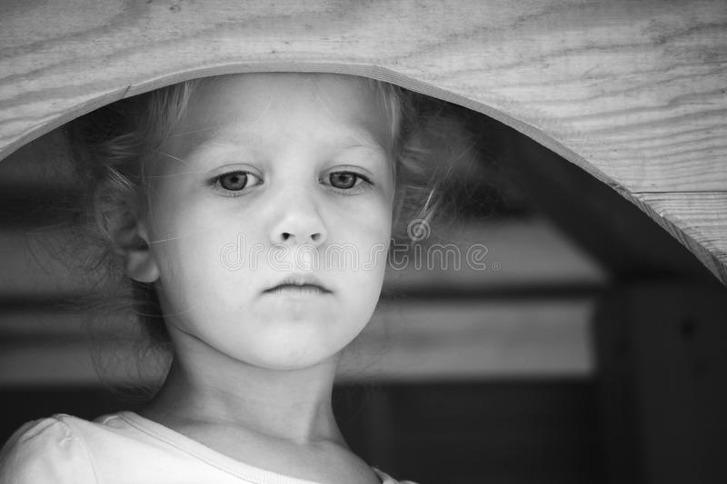 Little sad girl. Black and white series. royalty free stock image
