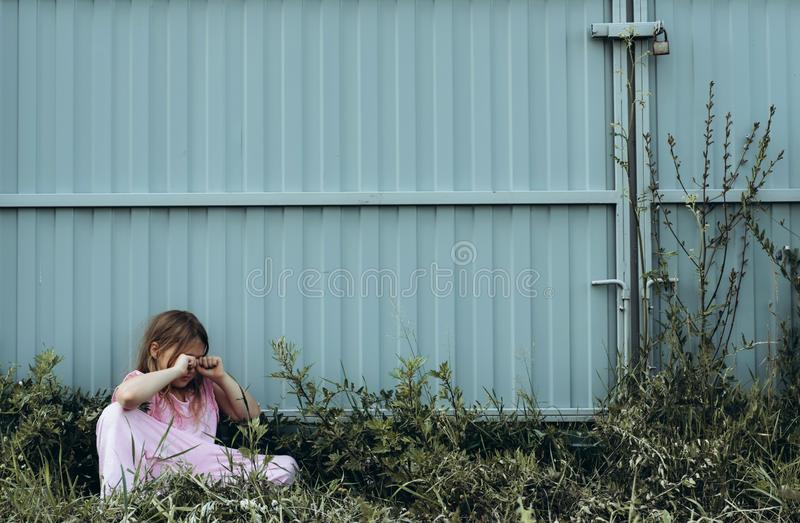 Little sad girl crying alone outdoor royalty free stock photography