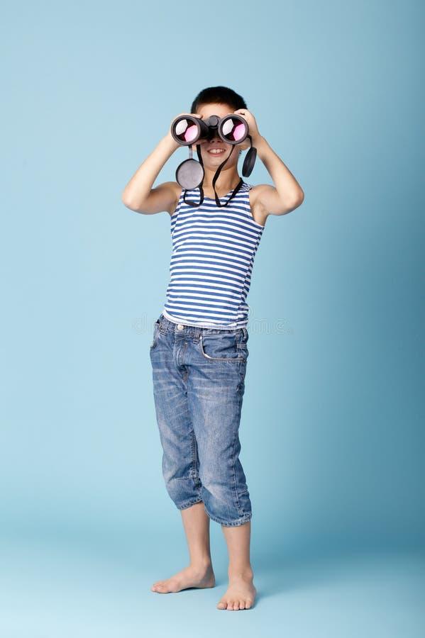 Little sailor with binoculars stock image