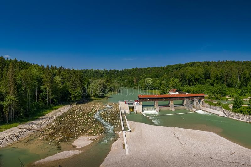A sandbank in front of the isar river and a weir, shot by a drone. royalty free stock images