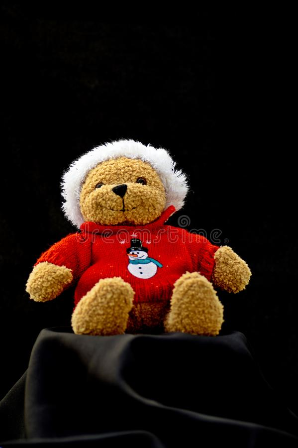 Little Santa Claus plush toy isolated on black background.  royalty free stock photography