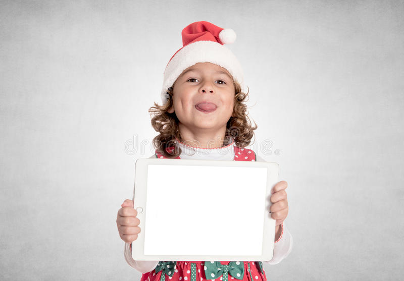 Little Santa mocking. And holding blank screen tablet pc royalty free stock photography