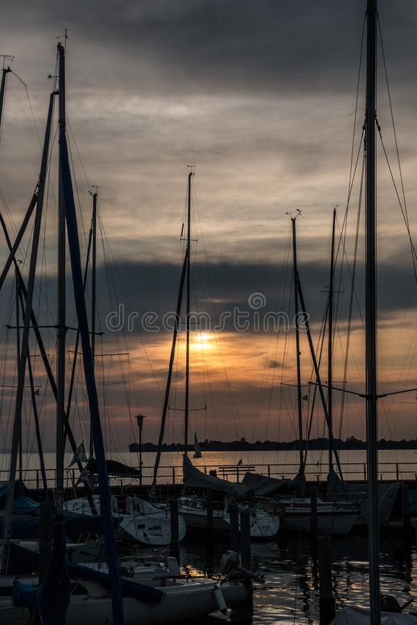 Little save haven with sailboats and a golden sunset.  royalty free stock photography
