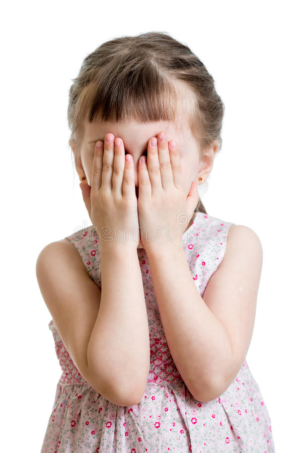 Little scared or crying or playing bo-peep kid hiding face stock photography