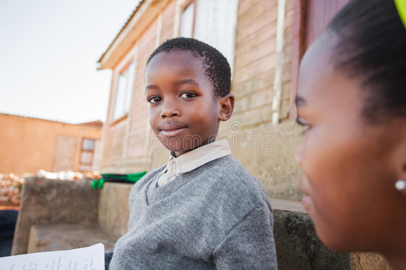 Little school boy staring at the girl stock image