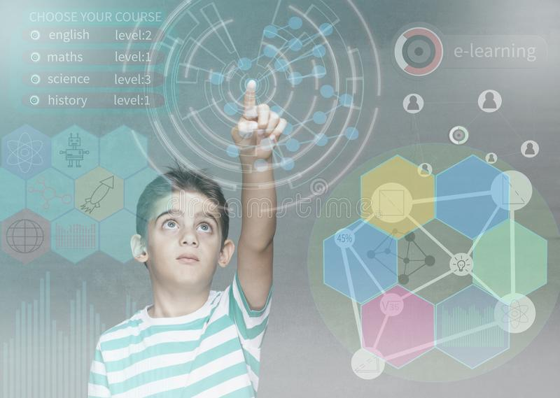 E-learning and futuristic education technology concept. Little school boy using digital hud interface and icons royalty free stock photography