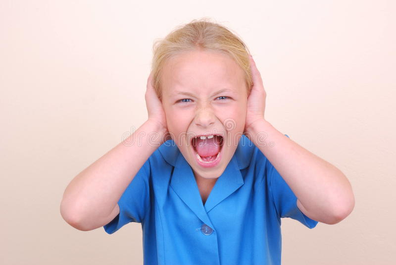 Little school girl screaming royalty free stock photos