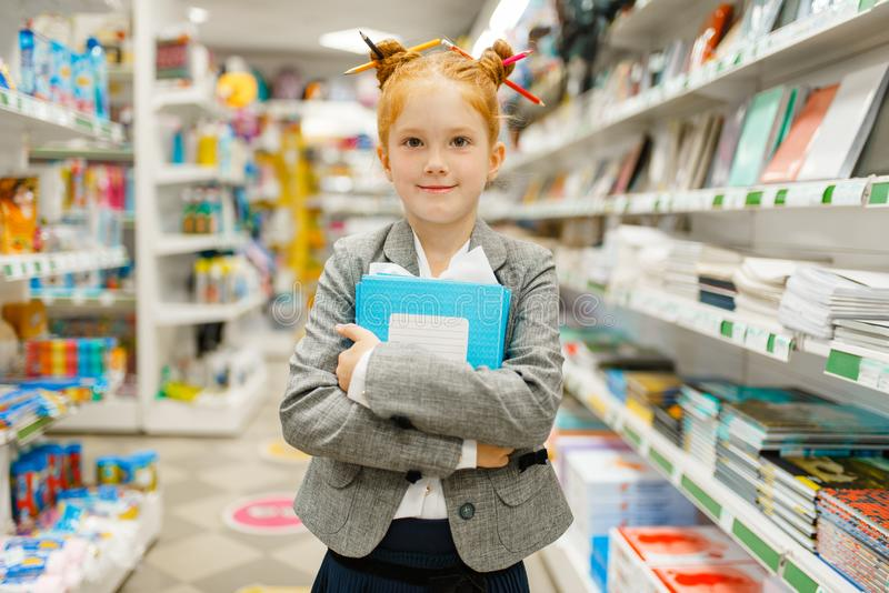 Little school girl in stationery store royalty free stock image